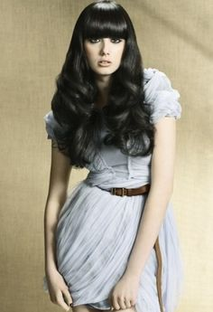Sleek hairstyle with voluminous ends and beautiful bangs