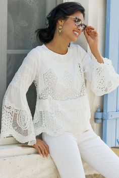 "Sometimes you need to reward your inner fashionista with something utterly fabulous. This 2-piece set features a striking woven top artfully accented with scalloped lace around the hem and cuffs; crocheted lace and embroidery create a diamond motif on the body; feminine sleeves flow from the elbow into a wide, floaty bell; and a soft, jersey-knit tank provides the backdrop. Exposed zip at back neck. Rayon; rayon/spandex. Misses 22"" long tank/24-1/2"" long shell. Artlette Top & Tank #2AW03"