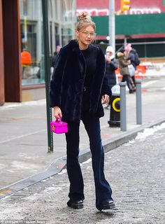 Bundled up! The ice cold weather wasn't stopping Gigi from hitting another fashion high no...