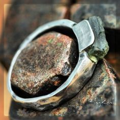 Hand forged stainless steel ring with moldavite. $122