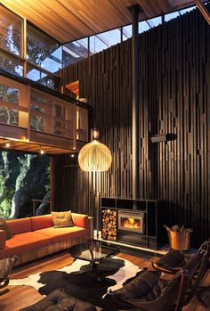 the interior design colors are way too dark for my liking.but I am completely intrigued by the architecture of this room! Under Pohutukawa House by Herbst Architects Sustainable Architecture, Interior Architecture, Building Architecture, Futuristic Architecture, Home Interior, Interior And Exterior, Exterior Design, Interior Doors, Natur House
