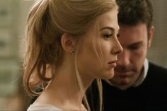DF-05063_05054_COMP5 -- Rosamund Pike portrays Amy Dunne, whose mysterious disappearance turns her husband into a possible murder suspect.