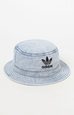 bfe5bc2ecf4 Finish any look with a fresh cap provided by adidas. The Blue Denim Bucket  Hat has a light denim fabrication and an adidas Trefoil logo on the front.