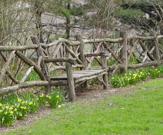 Rustic twig fence with built in bench