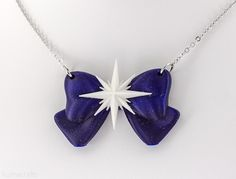 Sailor Saturn Bow Necklace $25 This necklace is 3d printed from a deep bluish-purple plastic with a hint of sparkles. Click through for more merchandise.