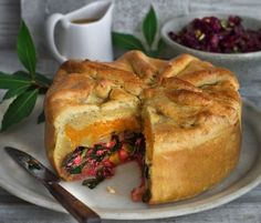 Goodwill Pie and sticky cider gravy with warm red cabbage and golden raisins