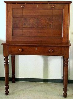 C. 1870 Walnut Plantation Desk with paneled ends. It is two piece with a drawer in the base and a drawer inside. It is 53' tall by 37-1/2' wide by 23' deep, the writing surface is 21' deep.