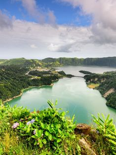 São Miguel Portugal: Expect panoramas of verdant valleys and lakes set in volcanic craters, plus the chance to see whales off the coast and go for a soak in natural hot springs. The Places Youll Go, Places To See, Largest Waterfall, Spain And Portugal, Portugal Trip, Round Trip, Vacation Destinations, Wedding Destinations, Vacations
