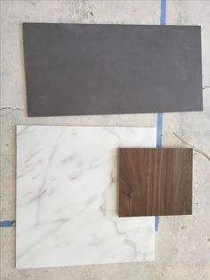 Grey tile floor, carrera marble counters and walnut wood cabinets! YAY we decided!