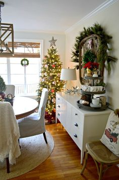 The dining room of our rustic and simple cozy Christmas cottage decorated in red with touches of gold. www.chafieldcourt.com