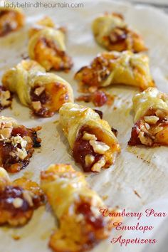 These pop in your mouth Cranberry Pear Envelope Appetizers scream PICK ME FOR YOUR HOLIDAY PARTY! Full of a sweet pear and cranberry sauce, topped with cr