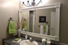 Bathroom Mirror Frame. This may be a great way to cover the ugly brass in our bathroom.