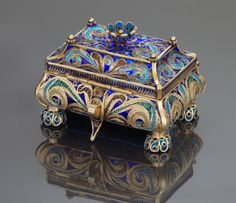 A RUSSIAN SILVER GILT PLIQUE-A-JOUR ENAMEL COVERED BOX . Ivan Khlebnikov, Moscow, Russian, c. 1888.