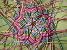 TUTORIAL:http://www.taringa.net/posts/arte/12177725/mandala-en-macrame-sarpados-colores-tutorial.html spanish but excellent visual tut!!
