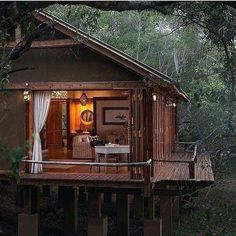 """stylish-homes: """" Cozy room among the treetops at the Tongabezi Lodge, located on the banks of the Zambezi River in Zambia. Keep reading """" Cabins In The Woods, House In The Woods, Cabin Homes, Log Homes, Style At Home, Forest House, Cabins And Cottages, Cozy Room, Home Fashion"""