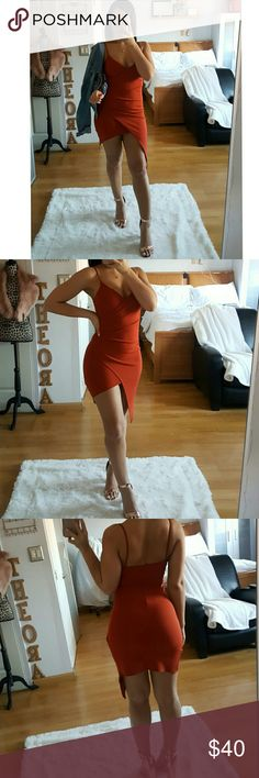 """""""DimePiece"""" Mini Wrap Dress NWOT Super cute RUST color Wrap Dress. Very Stretchy and form fitting. No closures just slips on. Straps aren't adjustable.  Material: Poly/Spandex👈  💫Measurements💫 Small: Length: 33"""" in Waist: 24""""in  Medium: Length: 34""""in Waist: 26""""in  Model is wearing a size SMALL*👈  👧Model Info👧 34B-25-38 130lbs  5'3  ◾BRAND NEW WITHOUT TAGS◾  🚫I DO NOT TRADE🚫  👉👉🔴PRICE IS FIRM🔴👈👈 Dresses Mini"""