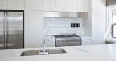 Classic white subway tiles and marble countertops. Via http://katewalkerstoneandtiledesign.com/