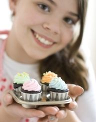 Cupcakes baked in ketchup cups - so cute for a party or a shower! You can use a flat baking sheet, too, as the cups are strong enough and dont need a muffin tin. #Recipes