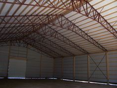 Hybrid.  Wood Posts with metal truss system.