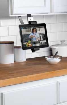 Belkin Kitchen Cabinet Tablet Mount... looks like it could keep it out of the way of ingredients....