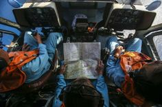 Military personnel work within the cockpit of a helicopter belonging to the Vietnamese airforce during a search and rescue mission off Vietnam's Tho Chu island, March 10, 2014. REUTERS/Athit Perawongmetha