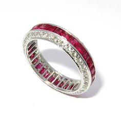 This is a stunning and truly unique wedding band. It features 1.45 carats of rubies and 0.55 carats of diamonds in a beautiful setting. Dare to be different! Appraisal Certificate as well as a beautif