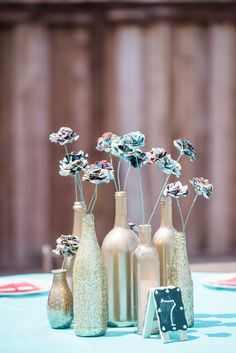 Stunning DIY gold wine bottle with comic book florals. View the full wedding here: http://thedailywedding.com/2016/07/28/creative-comic-book-wedding-jessica-david/