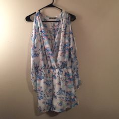 White floral romper Has only been worn once! Great for spring, though it is long sleeve it does have slits down the sleeve. Price not firm, make me an offer (: Dresses Long Sleeve
