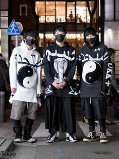 "Gaku, Yosuke, and Keito are three Japanese teens who caught our eye with monotone street styles in Harajuku at night. Gaku – on the left – is wearing a white KTZ ""United"" yin-yang t-shirt over a KTZ hoodie, Rick Owens shorts and Rick Owens high top sneakers. Gaku's favorite fashion brands include Rick Owens and Hood by Air. He likes the music of One OK Rock. Find Gaku on Twitter for more info. Ryosuke – in the middle – is wearing a KTZ ""Poison"" snake t-shirt over a hoodie, GU wide leg pants…"
