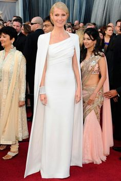 Gwyneth Paltrow After a series of Oscars looks that left the public divided (her sugary pink Ralph Lauren number in 1999) and shielding their eyes (the misjudged sheer gothic Alexander McQueen gown in 2002), the 2012 Academy Awards was Gwyneth's time to shine. It was certainly daring to wear a high fashion minimalist white Tom Ford gown and a matching cape to the Oscars, but it worked, big time, as this was the standout look on the famous red carpet. (2012)  Read more at…