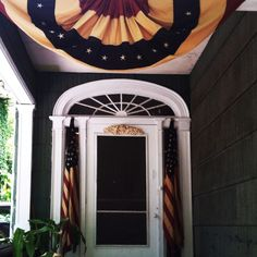 Patriotic antique flag porch decor.  Would LOVE to have this for my house.