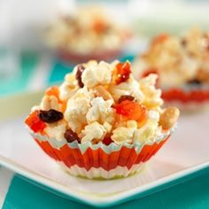 Popped corn, peanuts and dried fruit kissed with honey and lemon juice for a great snack to take anywhere