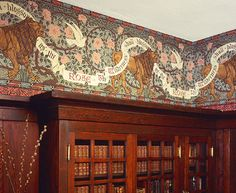 Room with paneling and built in bookcase --- Wallpaper: Lion and Dove Frieze - Arts & Crafts - Bradbury & Bradbury Art Wallpaper