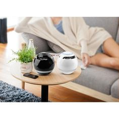 AiDu AY800 Wireless Bluetooth Mic Remote Control Speaker - A portable speaker designed to play your favorite music with the use of a Bluetooth Remote Control.