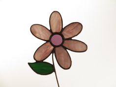 The pattern for this sun catcher was designed from a card my Mom sent me, so we named it 'Mom's Flower' - Hang this in your window to brighten your days or give it to someone you really care about!    This is ready to ship - and versatile too - add decoration to a potted plant or in an outdoor plant bed - just stick the stem in the dirt or, hang it in a window or on the wall!  The dimensions are 8 in x 4 in.    The first photo is on a light box with back lighting and the second photo is…