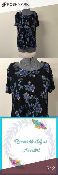 Black & Blue Floral Print Top XL Gorgeous black colored top with a beautiful blue floral print pattern all over. The material is soft feeling and stretches. This top is in excellent condition, no stains, snags or holes. Please ask if you have any questions, need measurements or more pictures. No trades. Notations Tops Blouses