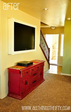 Build a box to cover up the sight of TV hanging brackets