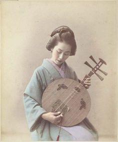 Woman Playing a Gekkin by Adolfo Farsari