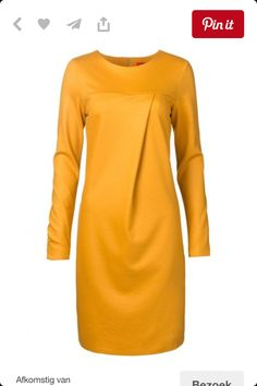 Lovely dress in the nice color ochreous.