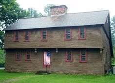 Stanley-Whitman House, in Farmington, Connecticut, is the oldest 18th-century structure in modern day Farmington. A centrally located chimney made of field & sand stone divides the house into two symmetrical halves. The original c.1720 house had four rooms & a third-storey attic space. Whitman added a lean-to onto the building in the mid-18th century, he expanded his family's living space & extended the roof line to create the classic saltbox silhouette for which Stanley-Whitman House is…