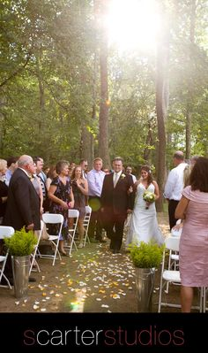 the bride and her father coming down the aisle in the wooded ceremony site / Clore Brothers Outfitters / www.scarterstudios.com