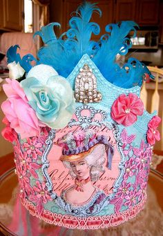 Made by Terri Gordon this Marie Antoinette inspired crown has beautiful and imaginative colors and has very detailed decorations.