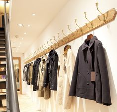 Use simple wall hooks to display fashion. a great idea for a temporary pop-up shop. Display Design, Store Design, Display Wall, Shop Interior Design, Retail Design, Nook, Dressing, Shop House Plans, Charity Shop