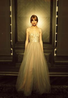 Taylor Swift... Cute looking in a great dress. Not too much going on, and great lighting.