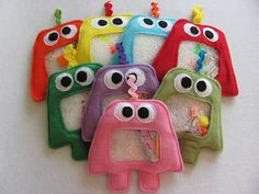NEW MONSTER design - I Spy Bags    LARGE SIZE    VERY LIMITED TIME!! - get yours before they are gone!    ~SUPER FUN~    I Spy Bags provide hours of entertainment for you lil munchkins. Over 30 treasures have been hidden in this one of a kind toy, and it is up to your child to find them all! As the child shifts through the non-toxic pellets in the enclosed pouch, new toys will emerge in the clear vinyl window allowing your child to find all the hidden treasures listed on the back for hours…