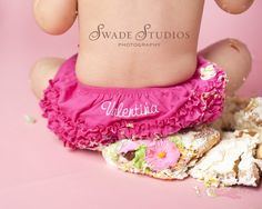 final cake smash shot, sitting on cake. Love this for Chloé's 1st birthday photo shoot.