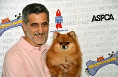 Animal trainer Bill Berloni makes friends with a Pomeranian #dog at Broadway Barks