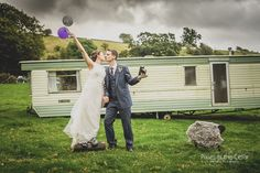 One of our more surreal shots at this Peak District Farm Wedding in Hartington - sheep, balloons and vintage camera!!