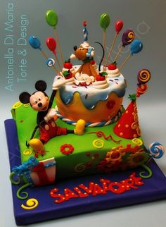 Mickey Mouse and the cake! by ninettaduci on Cake Central. This looks awesome I would love to try and make this one.