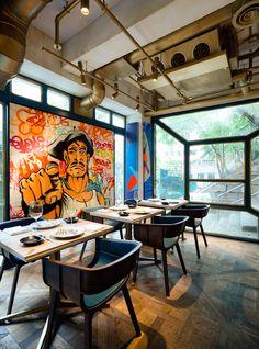 In a restaurant called Bibo, every wall has specially-made art by a famous street artists. #art #dining #streetart #HongKong